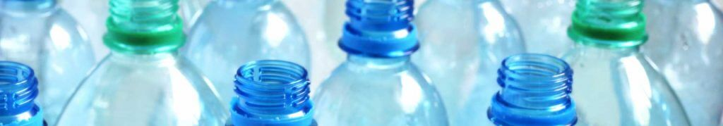 a photo of empty plastic bottles close up